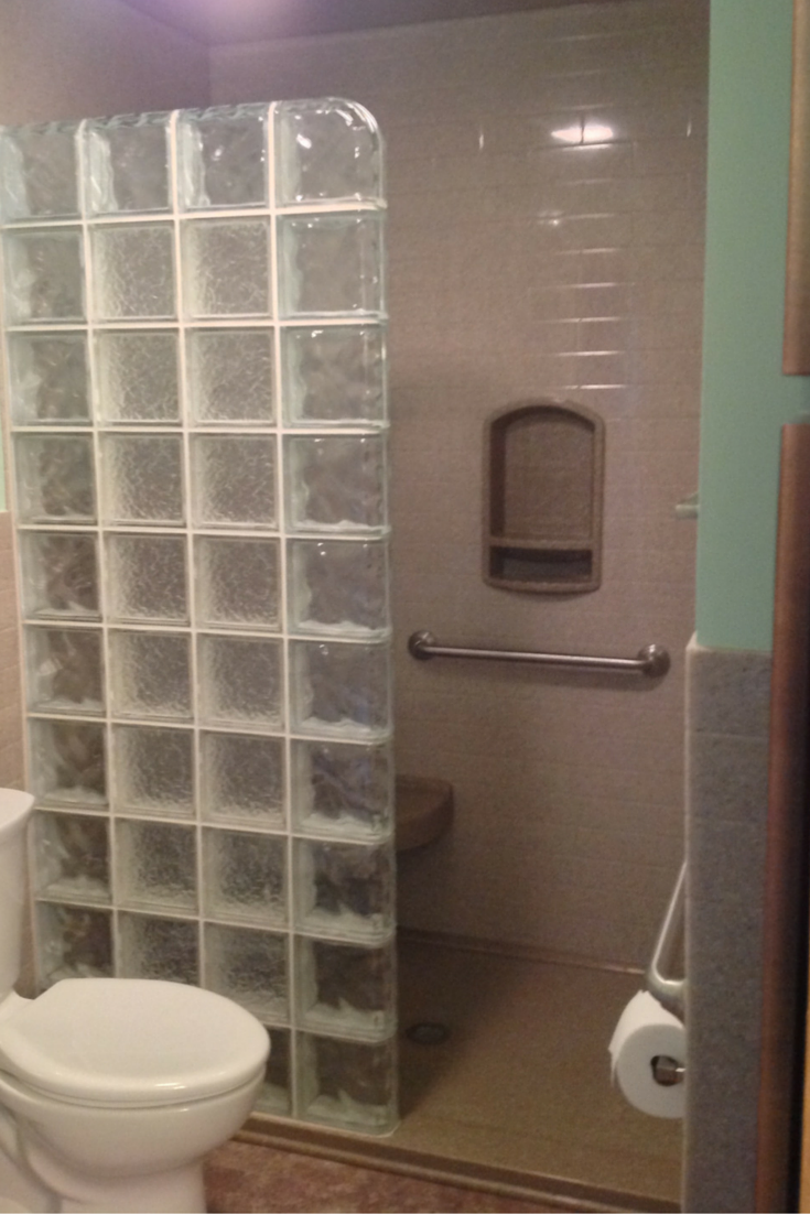 glass block walk in shower in an akron bathroom remodeling with a low profile solid surface base