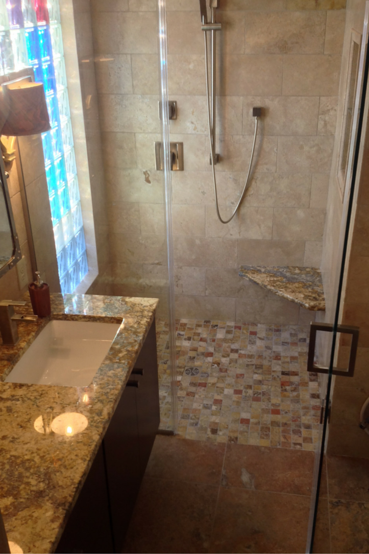 Bexley area of Columbus bathroom remodel with a custom tile shower and colored glass blocks for a window wall