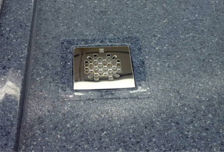 Stain resistant top view of a solid surface shower base