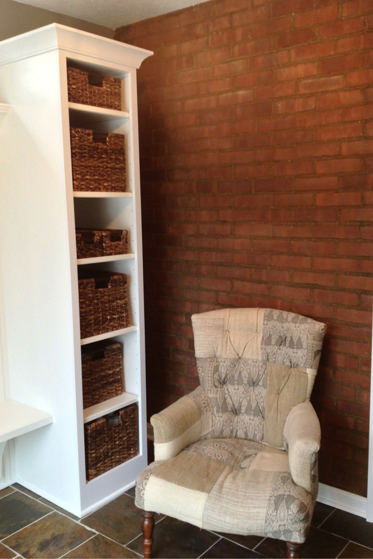 A relaxing chair in a mud room entryway in university heights ohio