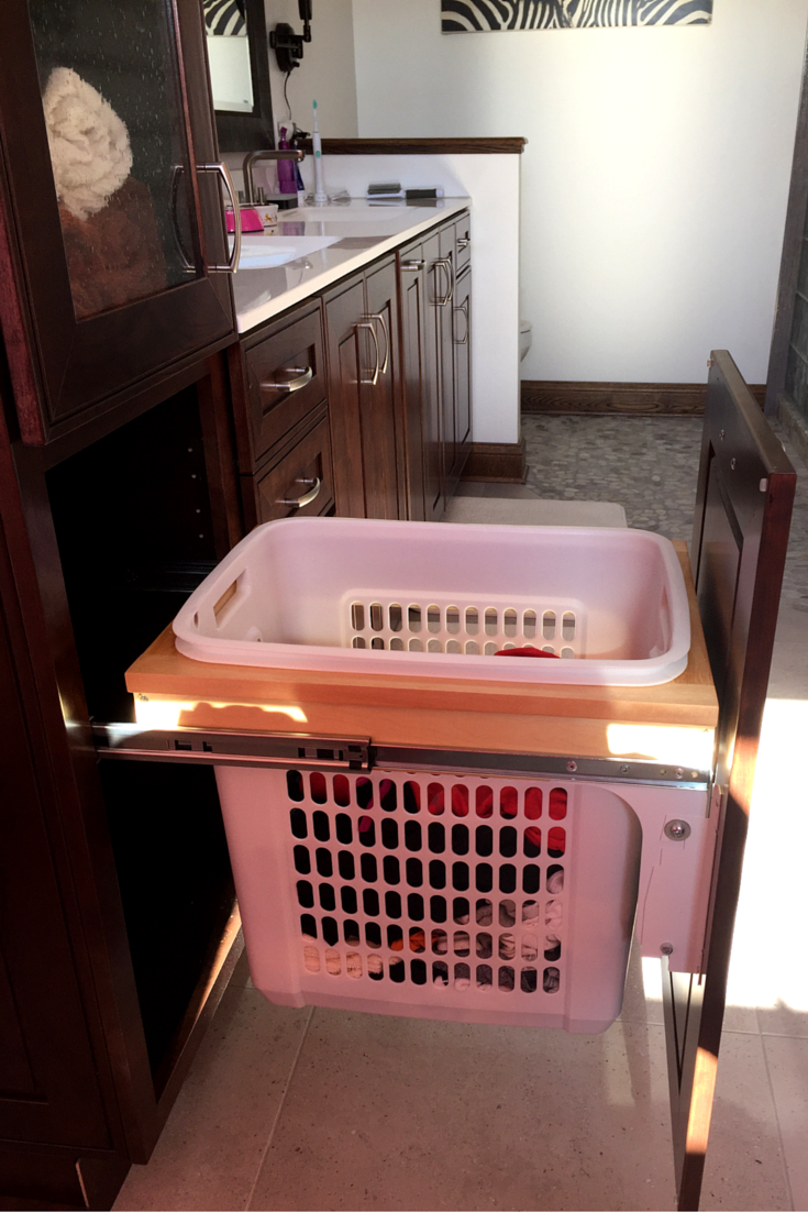 Pull out bathroom vanity cabinet drawers to be able to see what's in the back