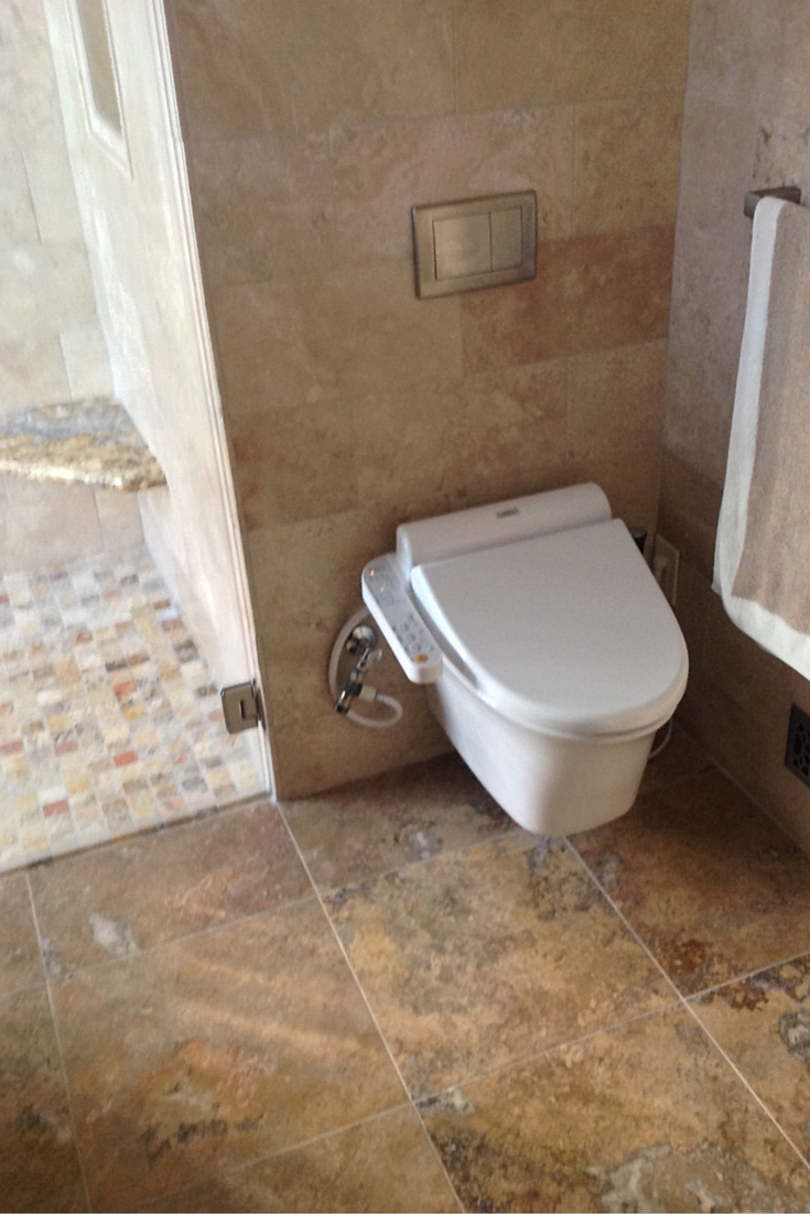 Wall mounted bidet and toilet combination from Toto called a Washlet