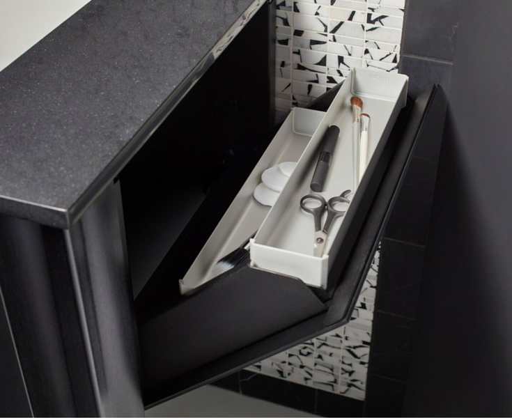 Wall mounted sink and vanity from Robern with places for scissors highlighters and brushes