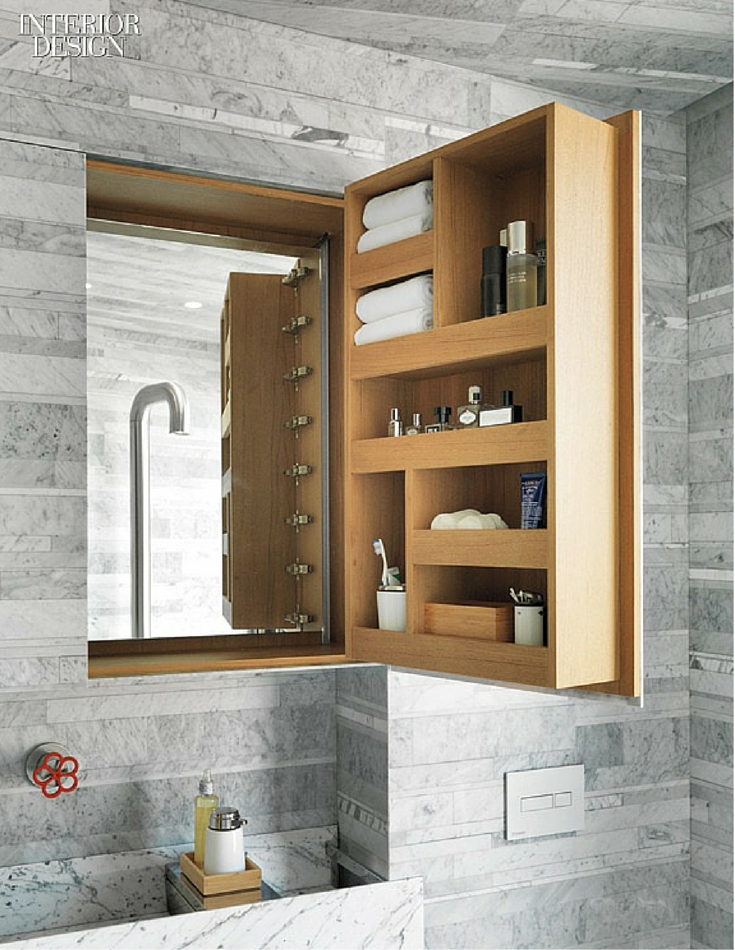 Custom made bathroom medicine cabinet with compartments for towels toothbrushes and toiletries