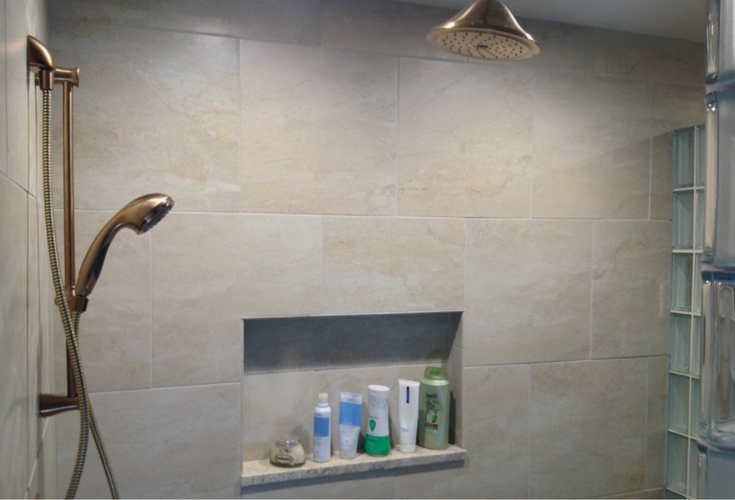 Adjustable shower head and rain head in a columbus bathroom remodeling project