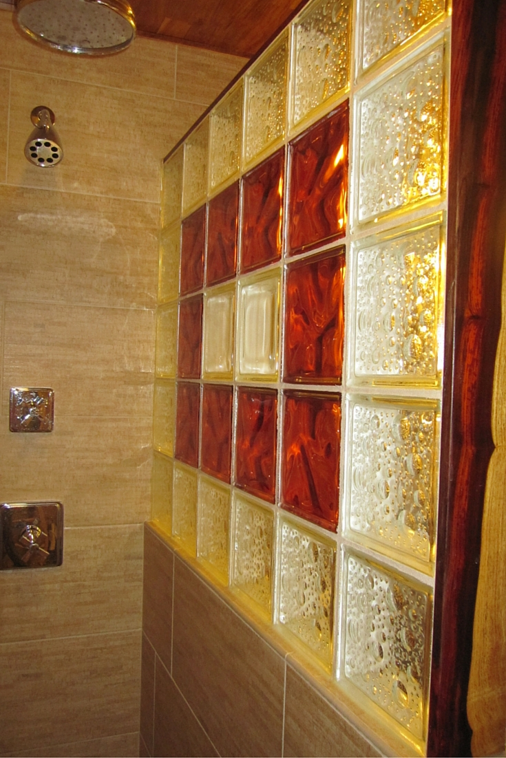 Cocobolo wood trim for a unique design glass block shower wall using icescapes and decora pattern glass blocks