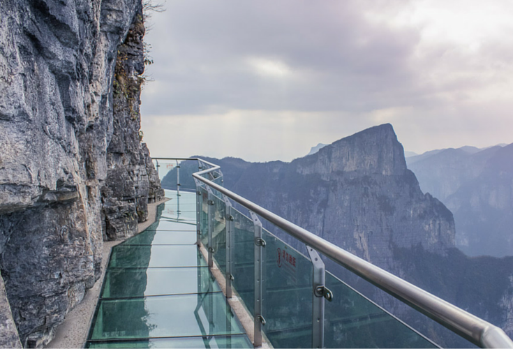 scary glass bridge on Tiananmen Mountain in China walk of faith bridge