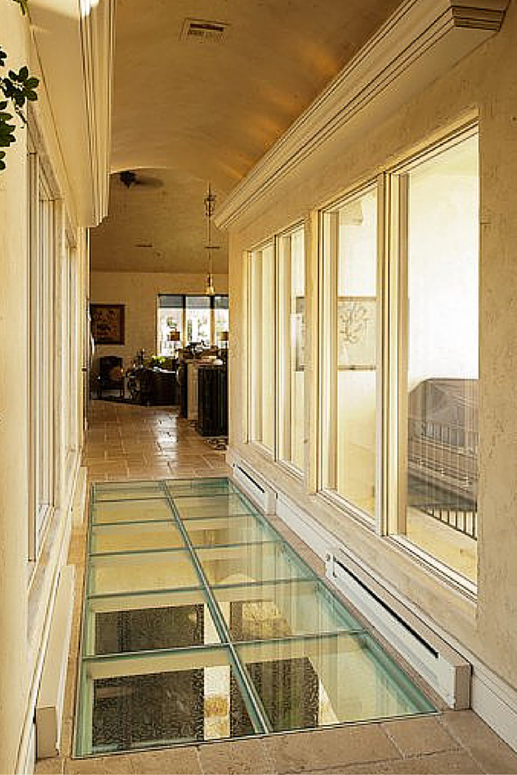 Glass flooring bridge in an upscale luxury home