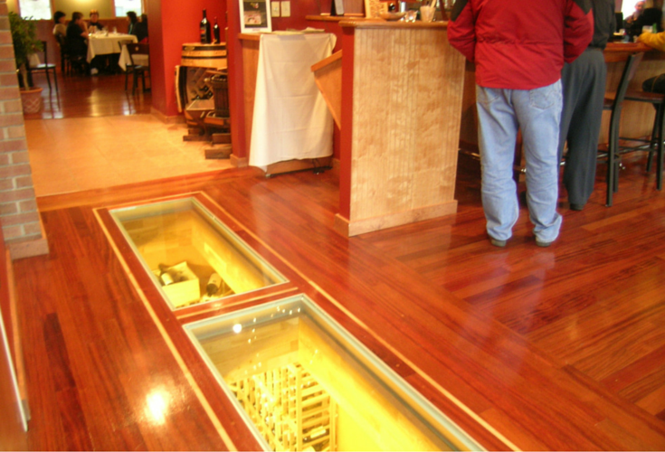 See through glass flooring in a restaurant with a wine cellar below
