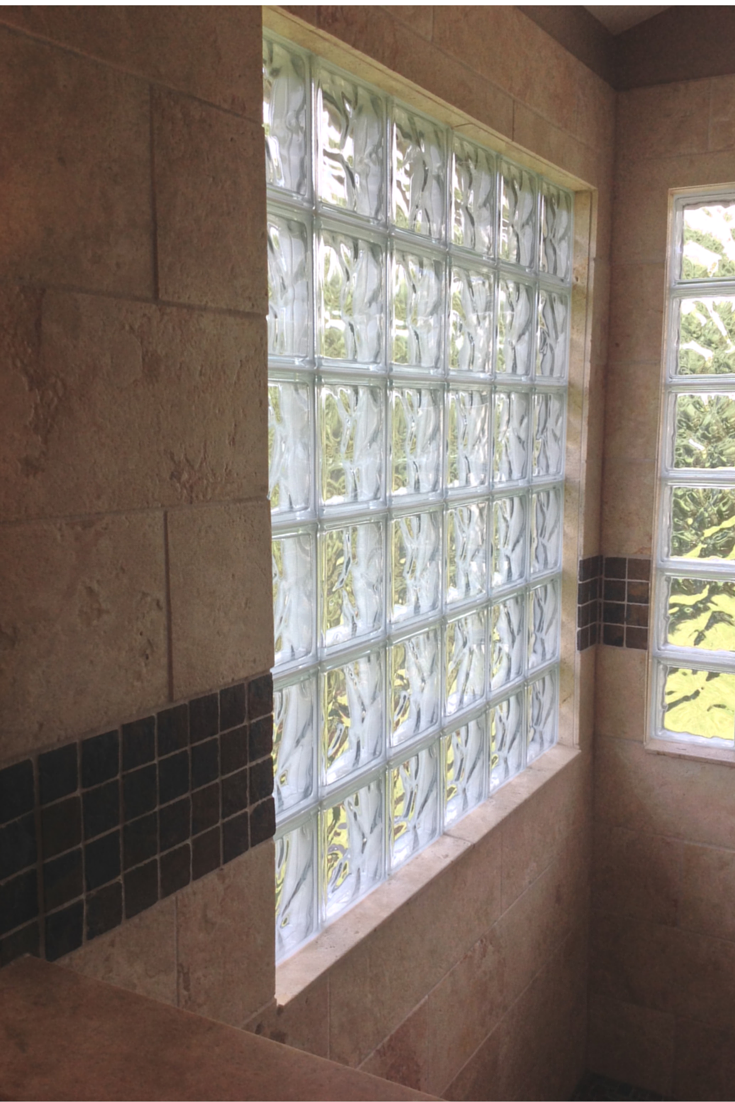 Glass block shower window lined on the inside with ceramic tile