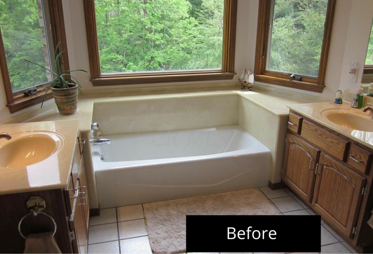 1980's Jack and Jill bathroom in Powell Ohio before remodeling with an outdated soaking tub and clear window with no privacy