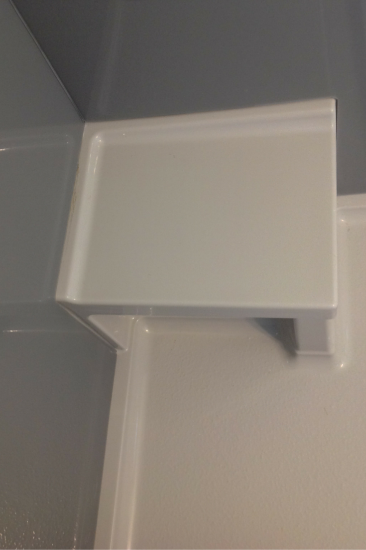 Grey acrylic shower pan with a built in bench seat in columbus ohio