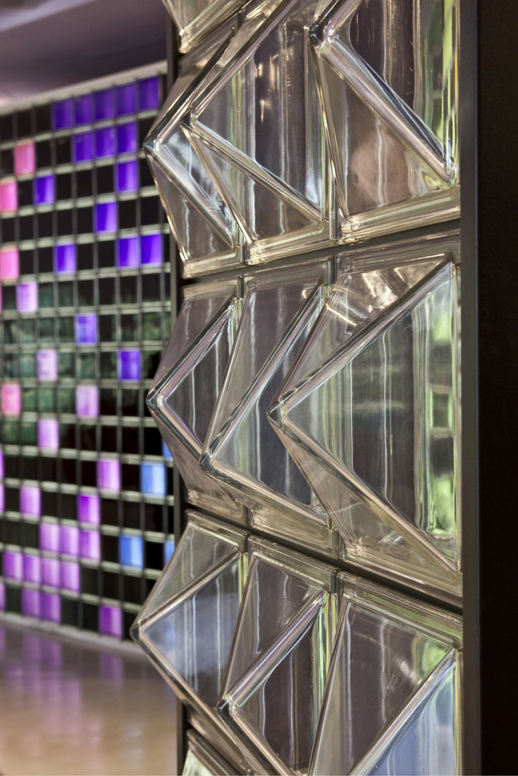 Textured glass wall partition in a pyramid type shape