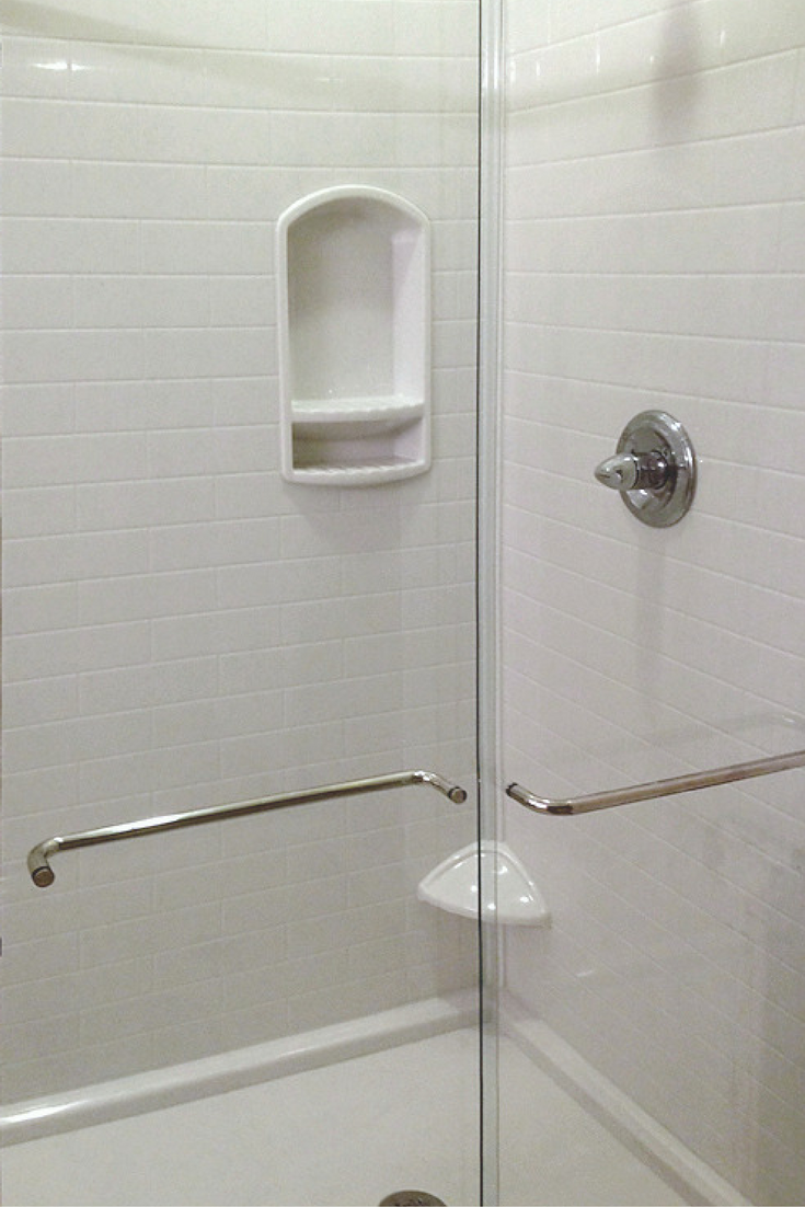 Sliding Glass Enclosure With A Solid Surface Shower Pan And Wall Panels