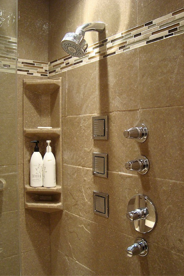 Textured solid surface shower wall panels with a decorative border