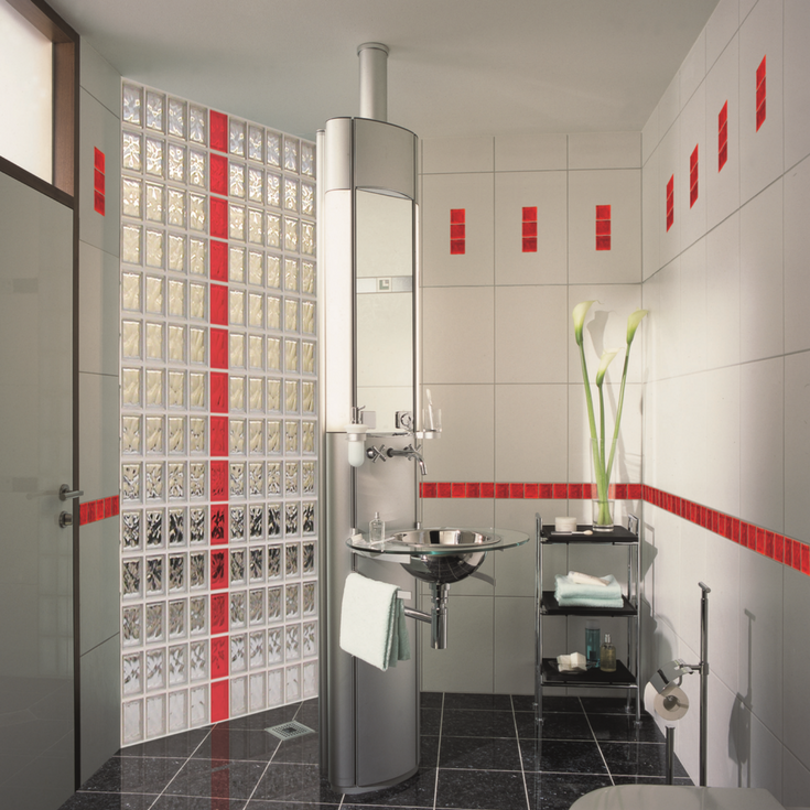 Fun red colored glass blocks in a shower wall partition in a contemporary apartment