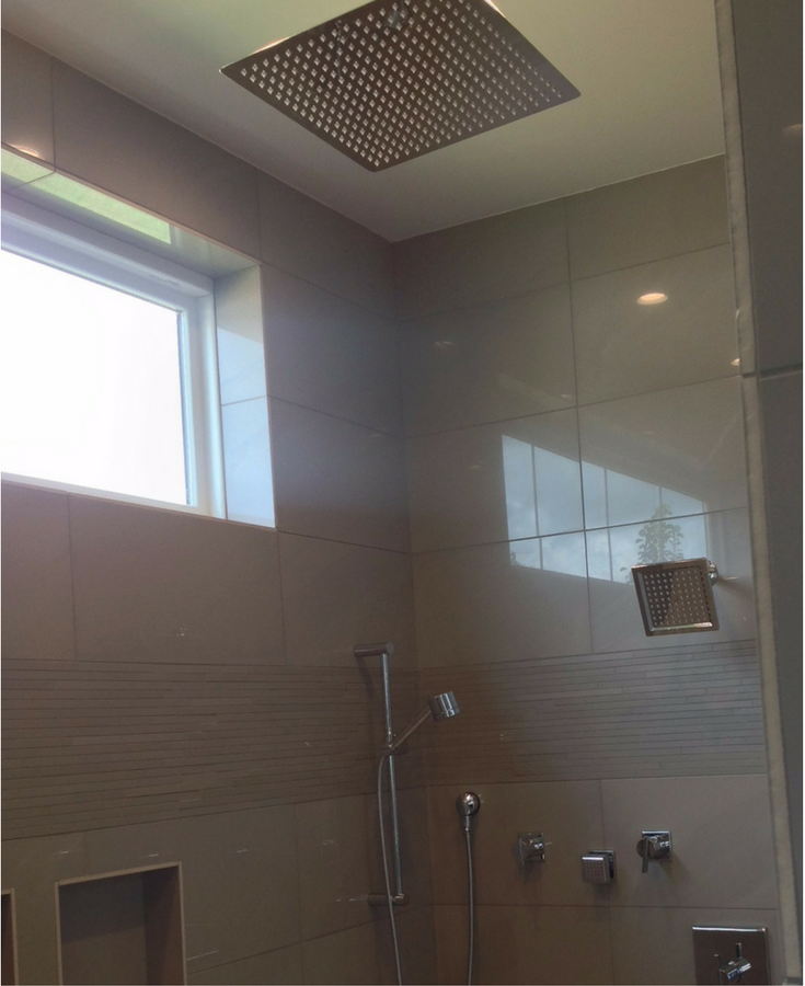Multiple shower heads in a tile shower in Columbus for a spa type experience