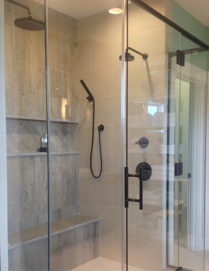 Multiple tile patterns and a niche row in an upscale shower in Columbus Ohio