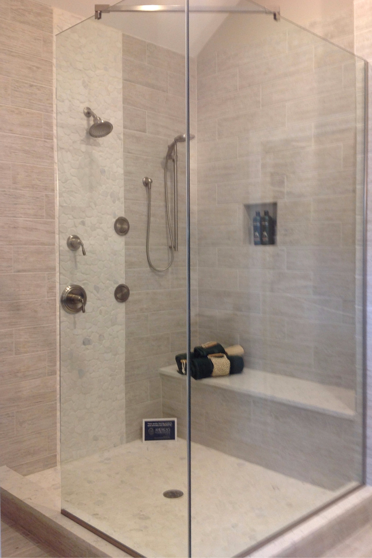 vertical tile row creates an interesting design in a bathroom with a vaulted ceiling - Luxury Tile Showers