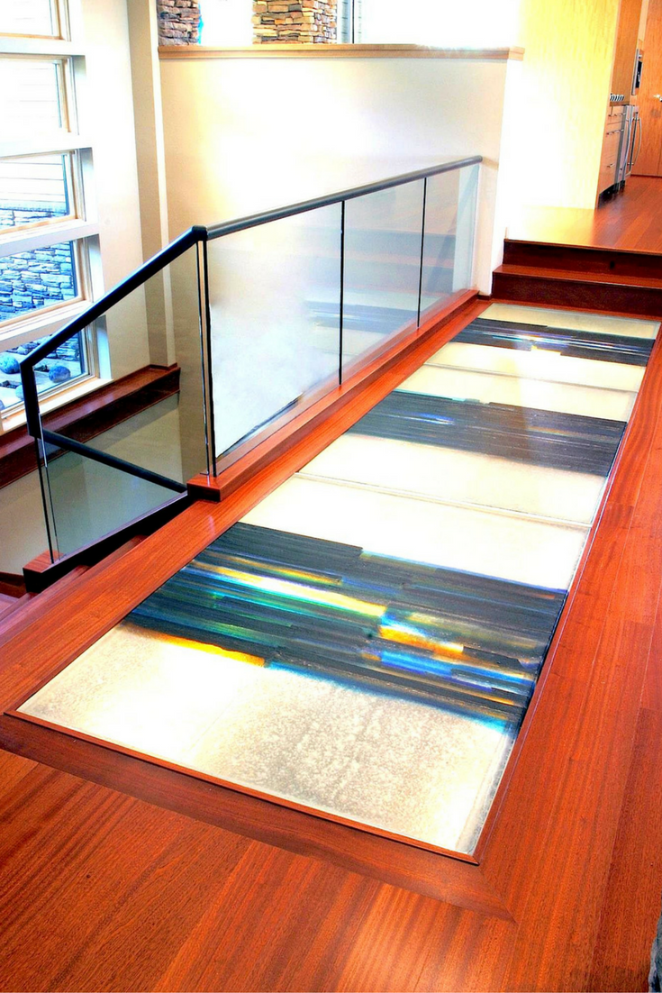 Cast glass art flooring system in a luxury home.