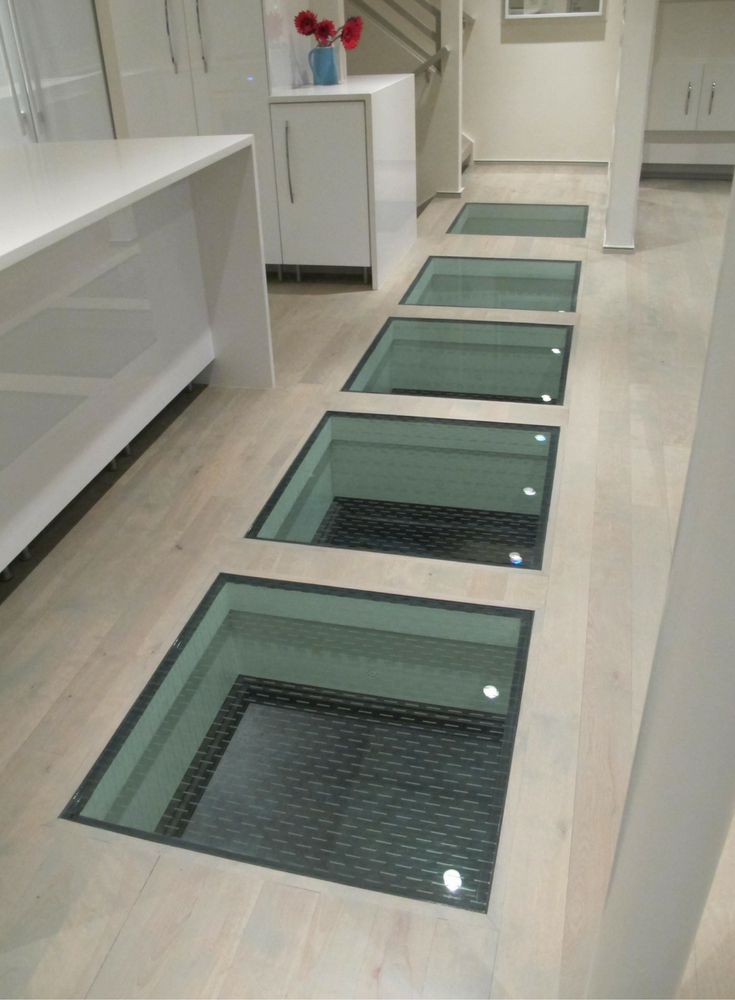 Ceramic glass frit for anti-slip traction control in a glass floor project in Kansas City Missouri.