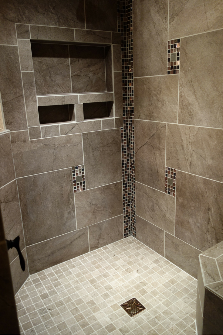 Large recessed niches in a custom tile shower with a no curb barrier free entry Innovate Building Solutions