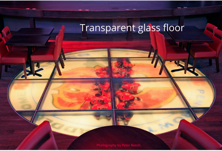 Transparent glass flooring in a lounge in a hockey arena
