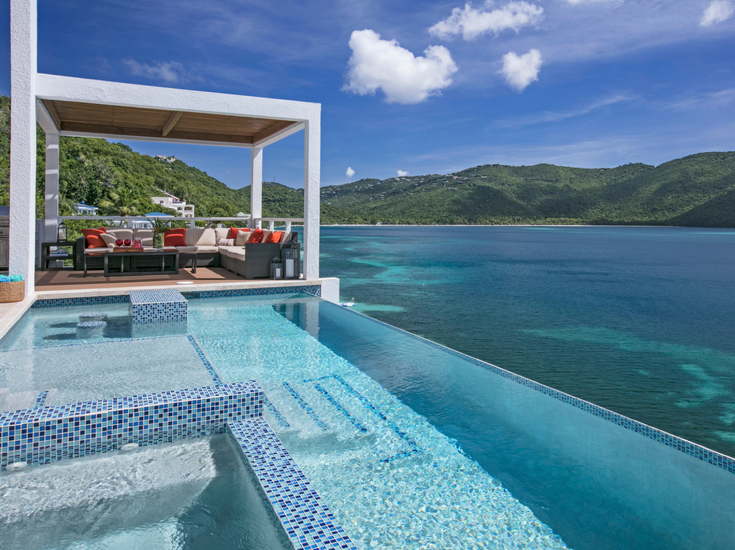 A daytime view of an infinity pool overlooking Magen's Bay in St. Thomas - @InnovateBuild