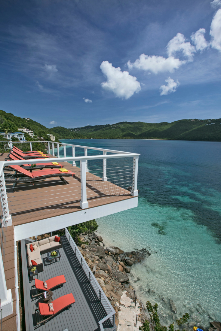 A cantilivered contemporary deck in a St. Thomas vacation home on Magen's Bay - @InnovateBuild