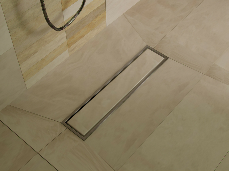 If you're going to DIY your shower remodel get the right drain kit. Shown here is a linear drain with a tile insert - Innovate Building Solutions