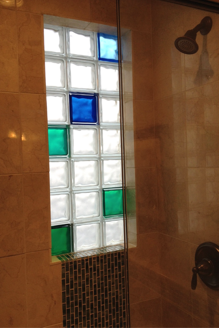 Multi-colored glass block shower window with green and blue glass blocks from Innovate Building Solutions