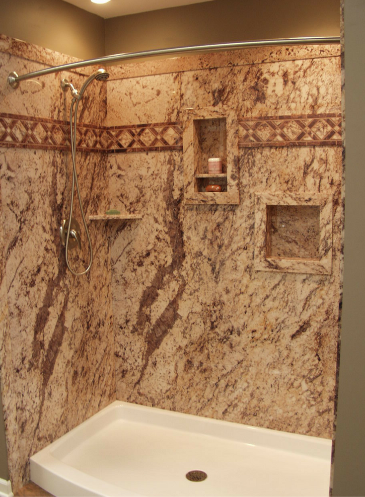 Don't forget shower storage in a DIY shower kit. Recessed niches shown in this faux marble wall panel system provide more storage. Innovate Building Solutions