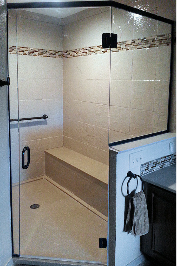 Cultured marble shower pan and a solid surface shower surround panels with a bench seat | Innovate Building Solutions