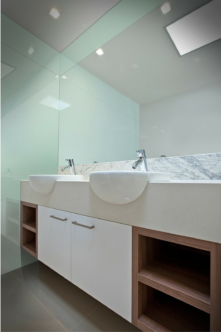 Glacier colored high gloss bathroom and shower wall panels for easy maintenance and reduced cost vs. back painted glass. | Innovate Building Solutions