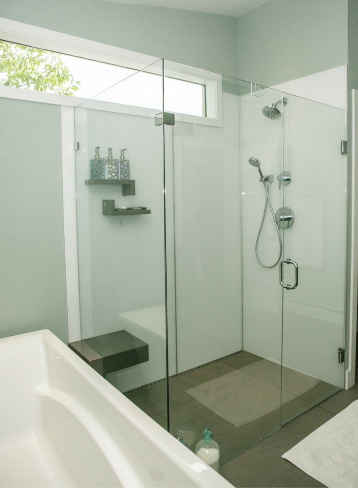 Glacier colored high gloss shower wall panels for a grout free shower from @InnovateBuild