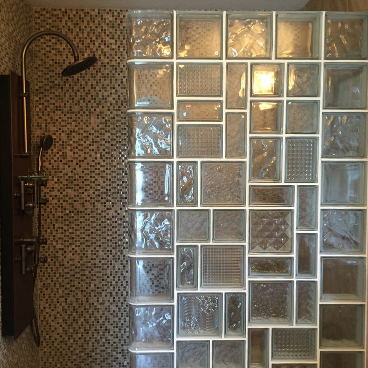 Glass block shower wall with multiple sizes and patterns for a leaded glass type look in a tile shower. | Innovate Building Solutions