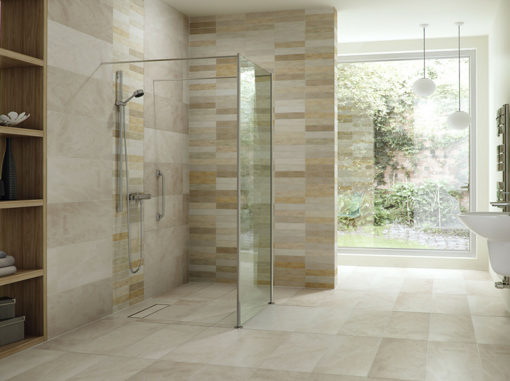 One level wet room with a linear drain and larger floor tiles - Innovate Building Solutions