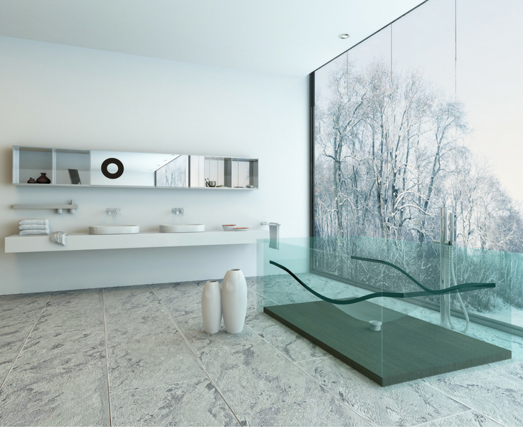 Glass bathtub in an upscale contemporary minimalist home. | Innovate Building Solutions