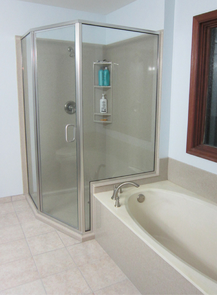 Angled custom solid surface shower enclosure and wall panels | Innovate Building Solutions