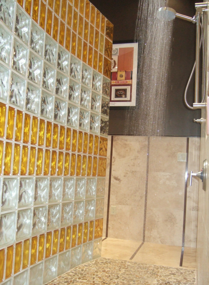 Colored and curved glass block shower with different sized blocks | Innovate Building Solutions