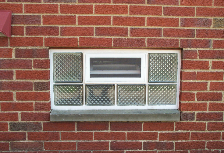 Diamond pattern glass block window with an air vent for ventilation | Innovate Building Solutions