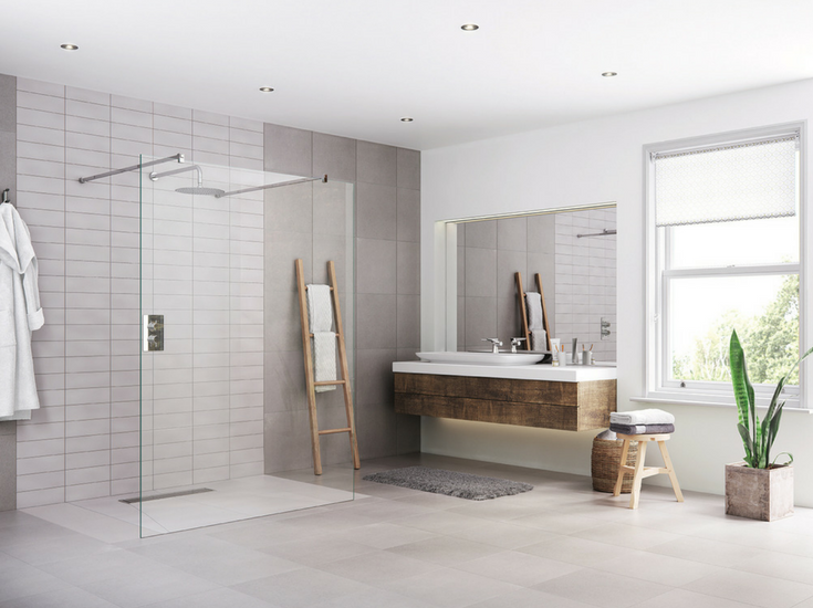 Large format tiles used in an accessible one level bathroom | Innovate Building Solutions