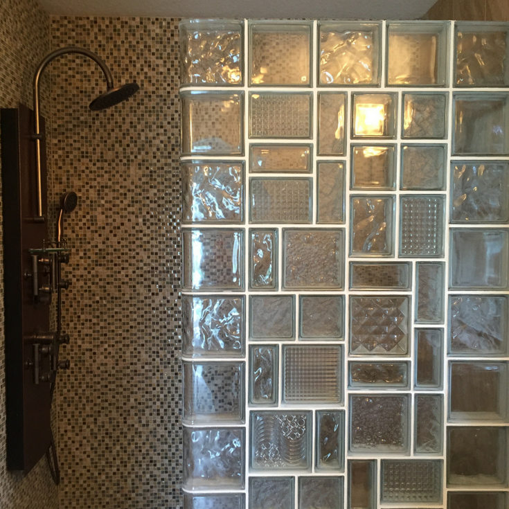 Leaded glass looking glass block shower wall with different patterns and sizes for a unique design - Innovate Building Solutions