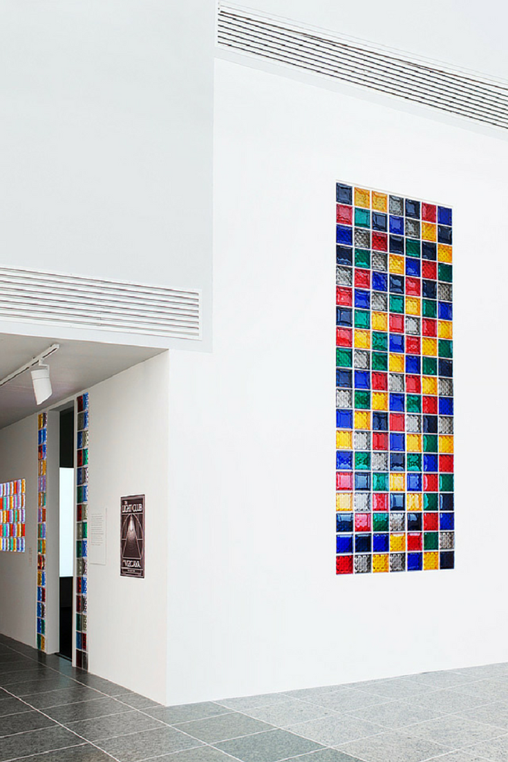 Multi colored glass block window in a minimalist luxury home | Innovate Building Solutions