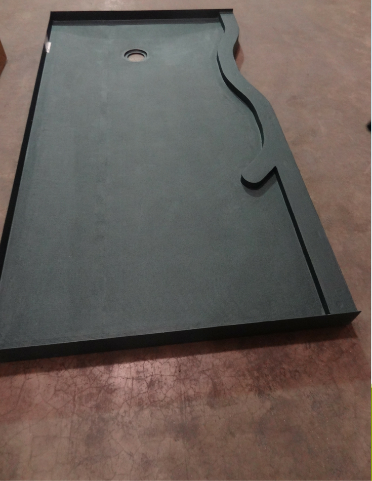 Odd shaped serpentine shower curb in a waterproof ready for tile base which will be finished with a custom glass block shower wall | Innovate Building Solutions