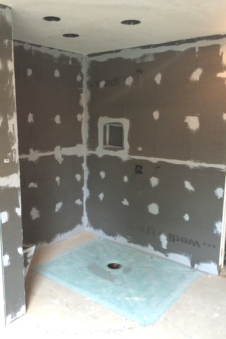 One level wet room shower pan during the installation process in a Cleveland Ohio bath remodeling project | Cleveland Design and Remodeling divison of Innovate Building Solutions