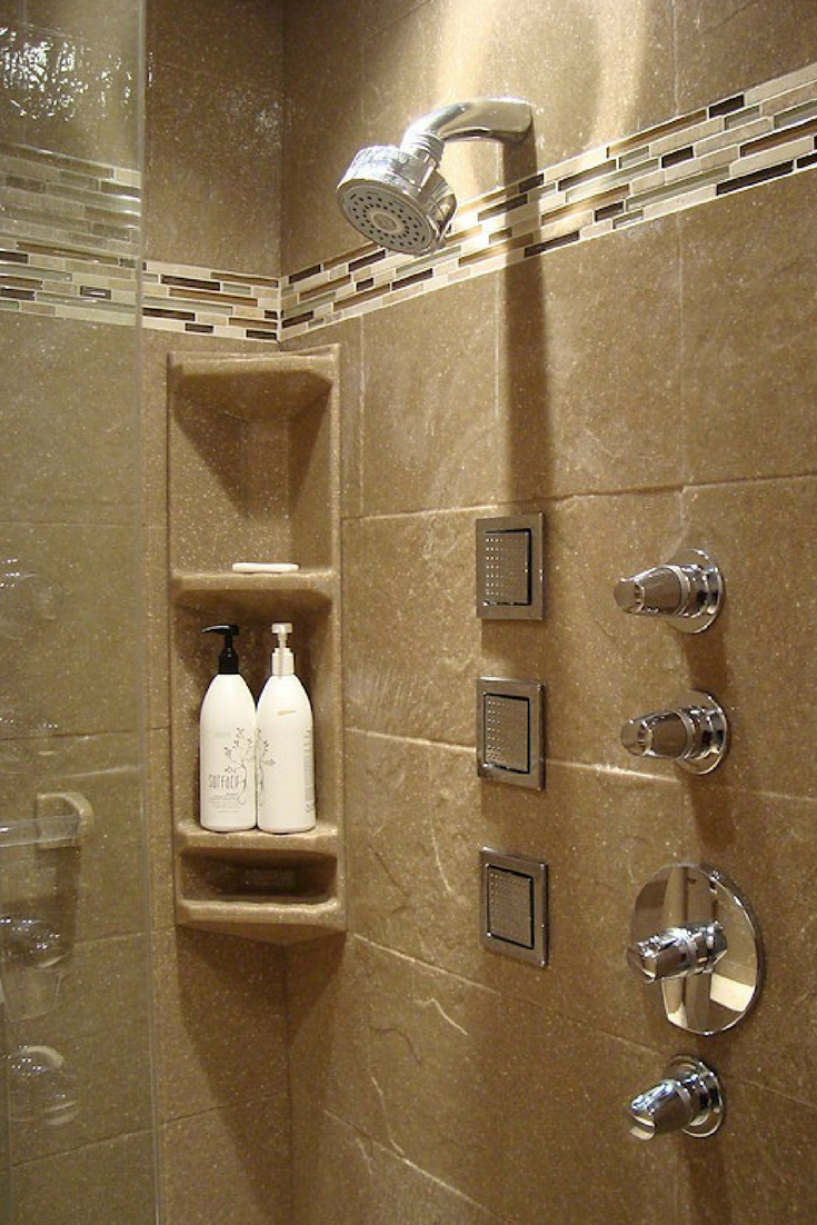 Solid surface shower wall panels with a tile border add style and lower maintenance costs. | Innovate Building Solutions