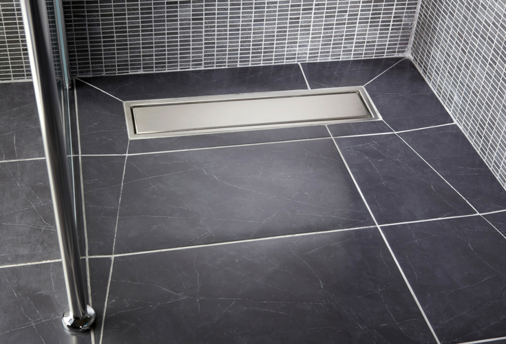 Linear tile shower drain with larger tiles for less grout lines | Innovate Building Solutions