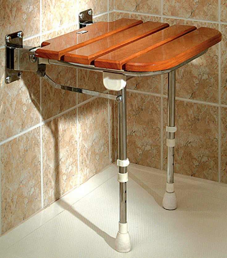 Teak fold down seat provides seating in a tub to shower conversion project | Innovate Building Solutions