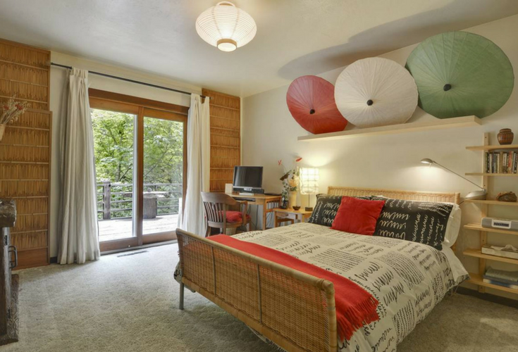A Japanese inspired bedroom with fun looking umbrellas in a vacation rental home in Cazadero California - Innovate Building Solutions